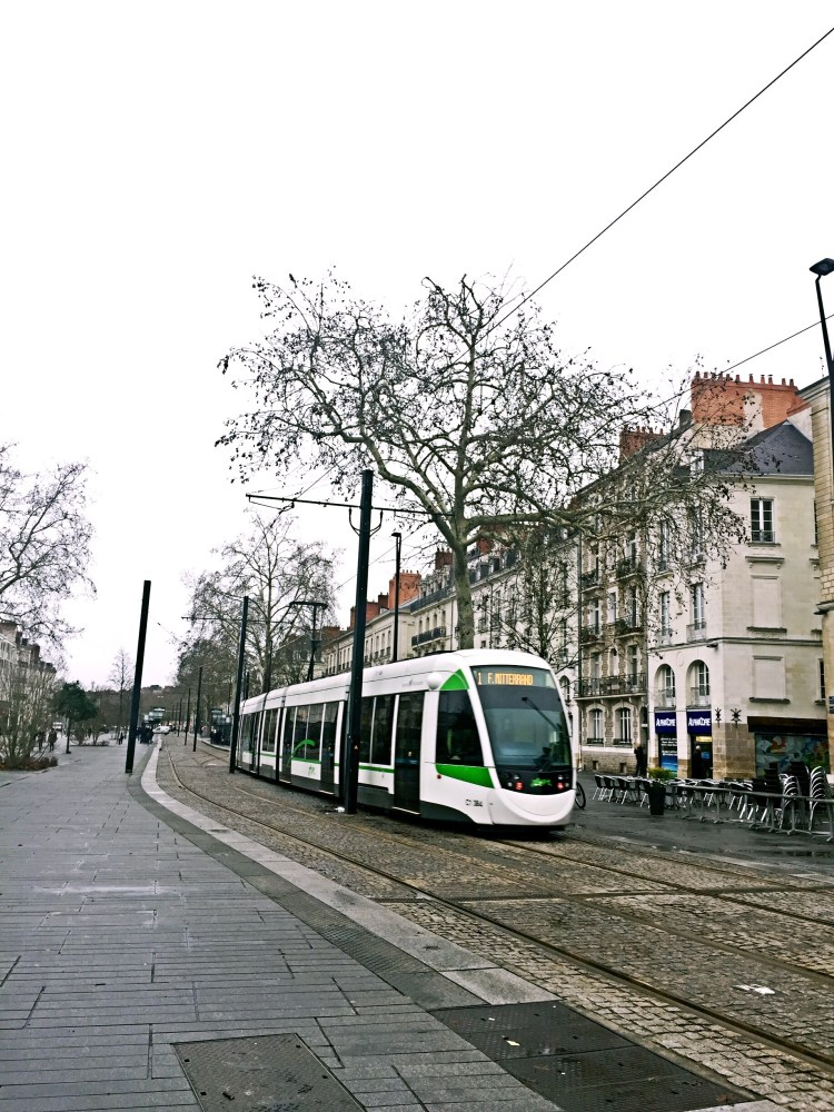 Street in Nantes with tram passing