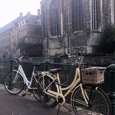 White bikes by church - Ghent street art