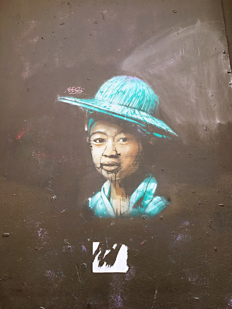 Lady with the hat by Guaté Mao - Street art Montpellier