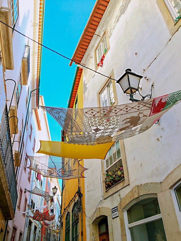 Charming street in Coimbra with hanging decorations - One day in Coimbra