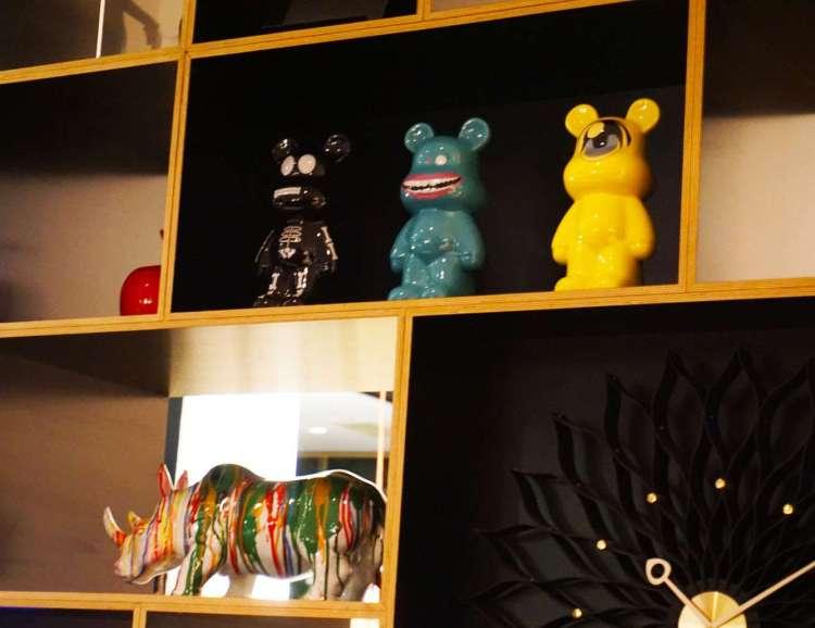 Cute decorations on shelf - CitizenM hotel Glasgow
