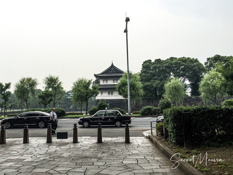 View of the Imperial Palace with two black taxi passing through, Tokyo