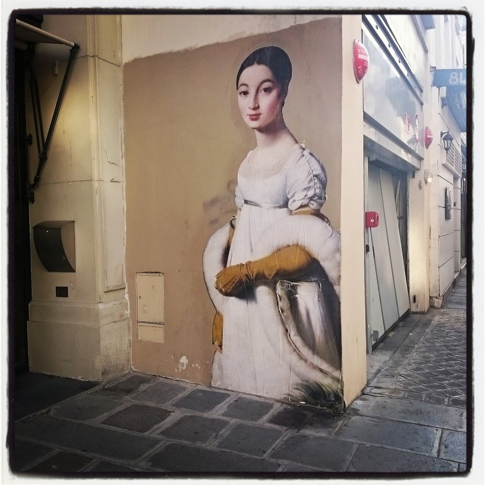 An Ingres portrait in street art/poster on the Rue St-Honoré