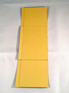 """The side panel: 3"""" x 9 3/4"""" Scored at 2 3/4"""" and 7"""" and cut slits as shown. This piece is slightly larger on the sides so you can trim to your liking."""