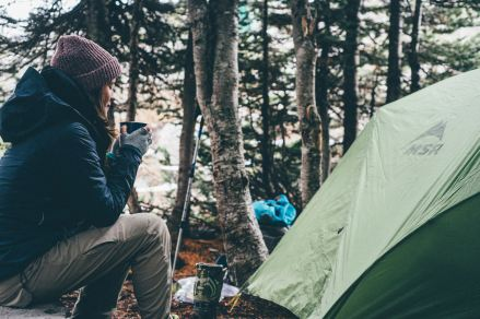 A camper enjoying a cup of coffee in the morning
