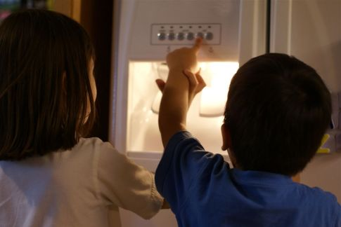 Even kids know how to use a refrigerator water dispenser