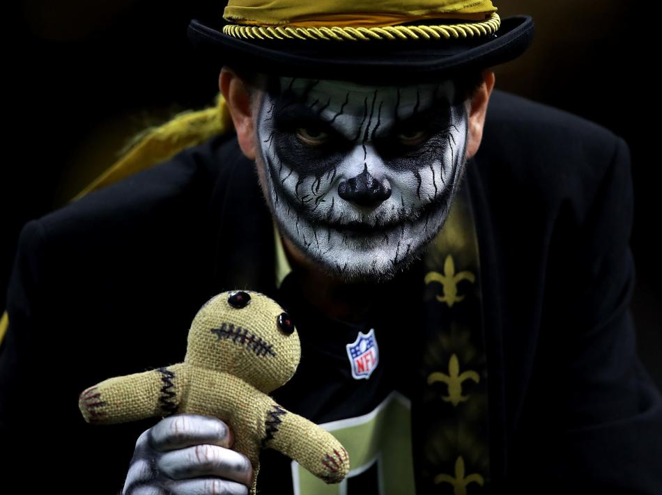 The NOLA witch doctor. His face painted black and white holding a voodoo doll.