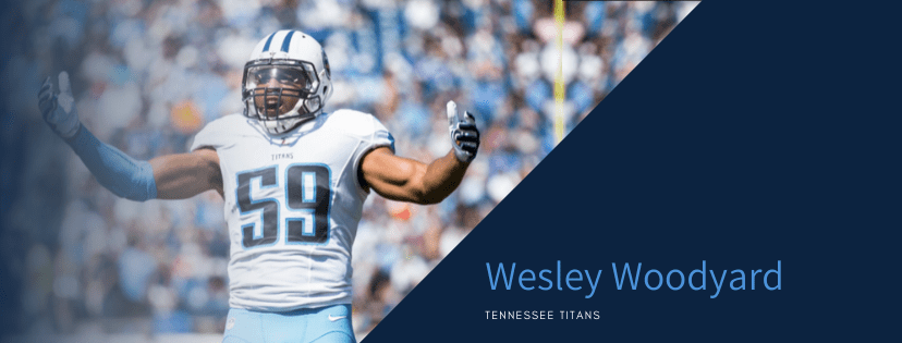 Tennessee titans football line backer in white uniform player with his hands up