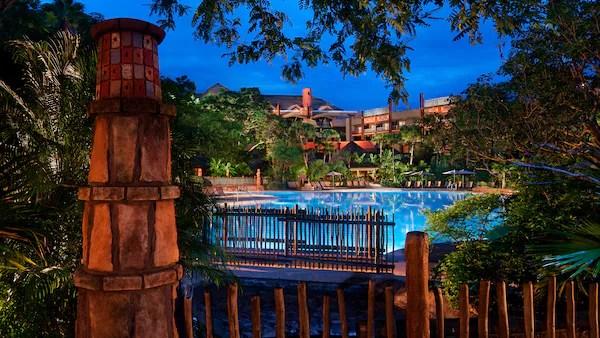 The Uzima Pool area at Disney's Animal Kingdom Lodge, lit up at night