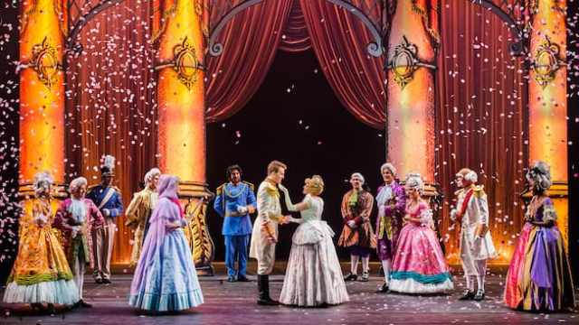 A stage play featuring Cinderella, Prince Charming and members of a royal court