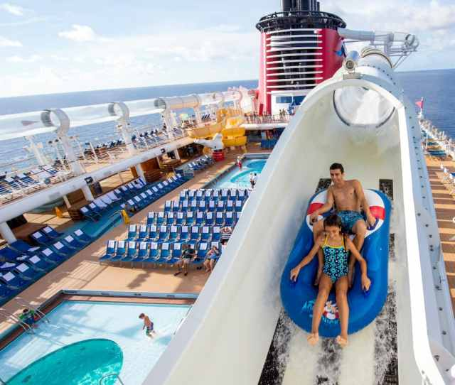 A Boy And Girl On A Raft Plunging Down A Water Tube On A Disney Cruise