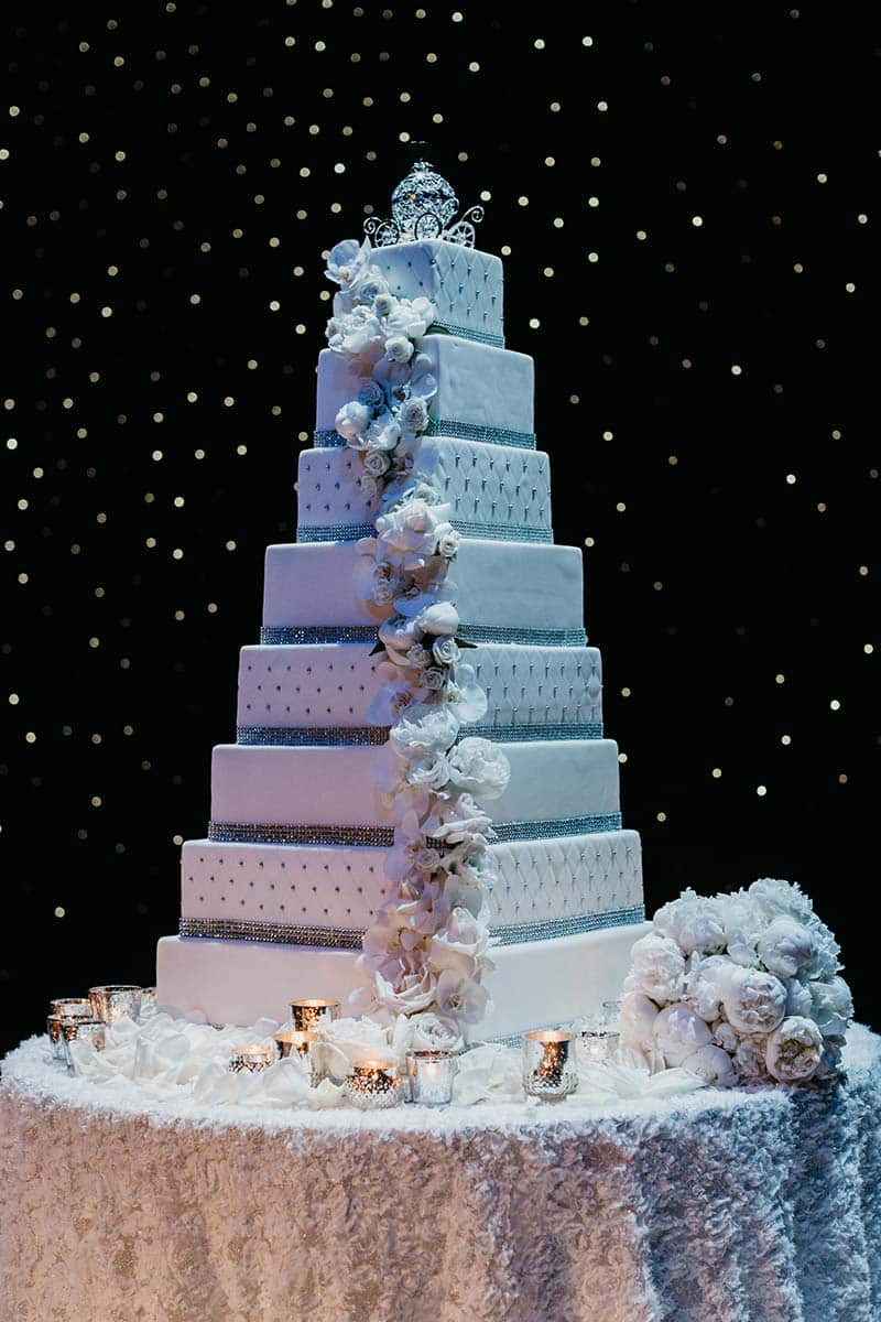Wedding Cake Wednesday  Towering Elegance   Disney Weddings Glistening under the twinkling lights  this touch of  Disney  transforms  this wedding cake into something truly magical