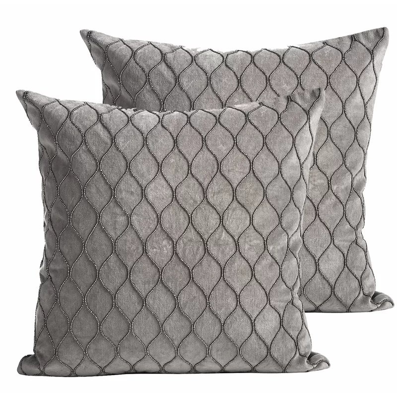 two black throw pillows with insert