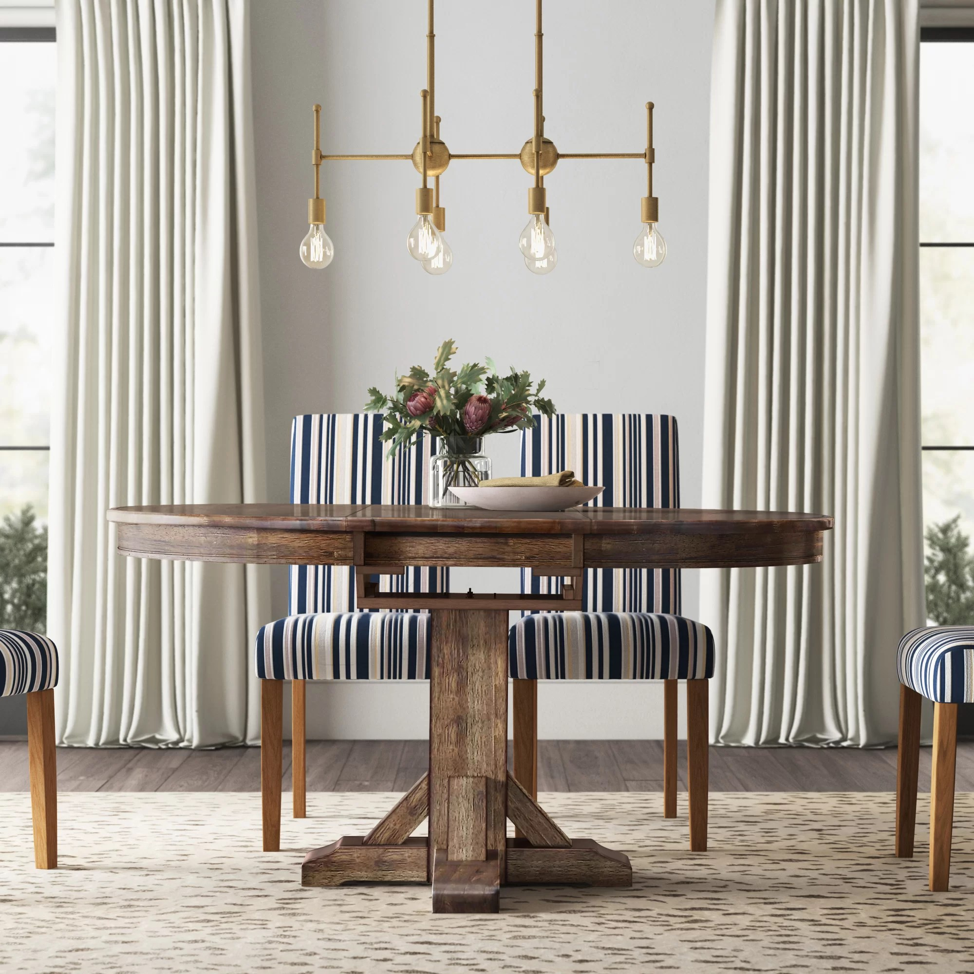 Charmine Extendable Solid Wood Oval Dining Table Reviews