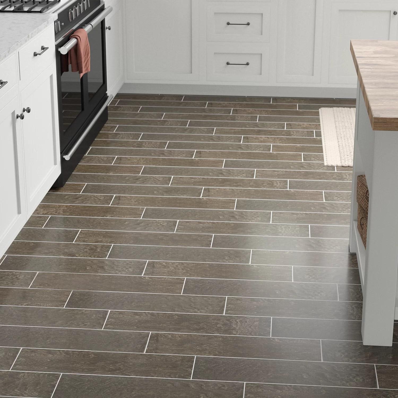 modern visual 6 x 24 porcelain wood look tile in smoky brown
