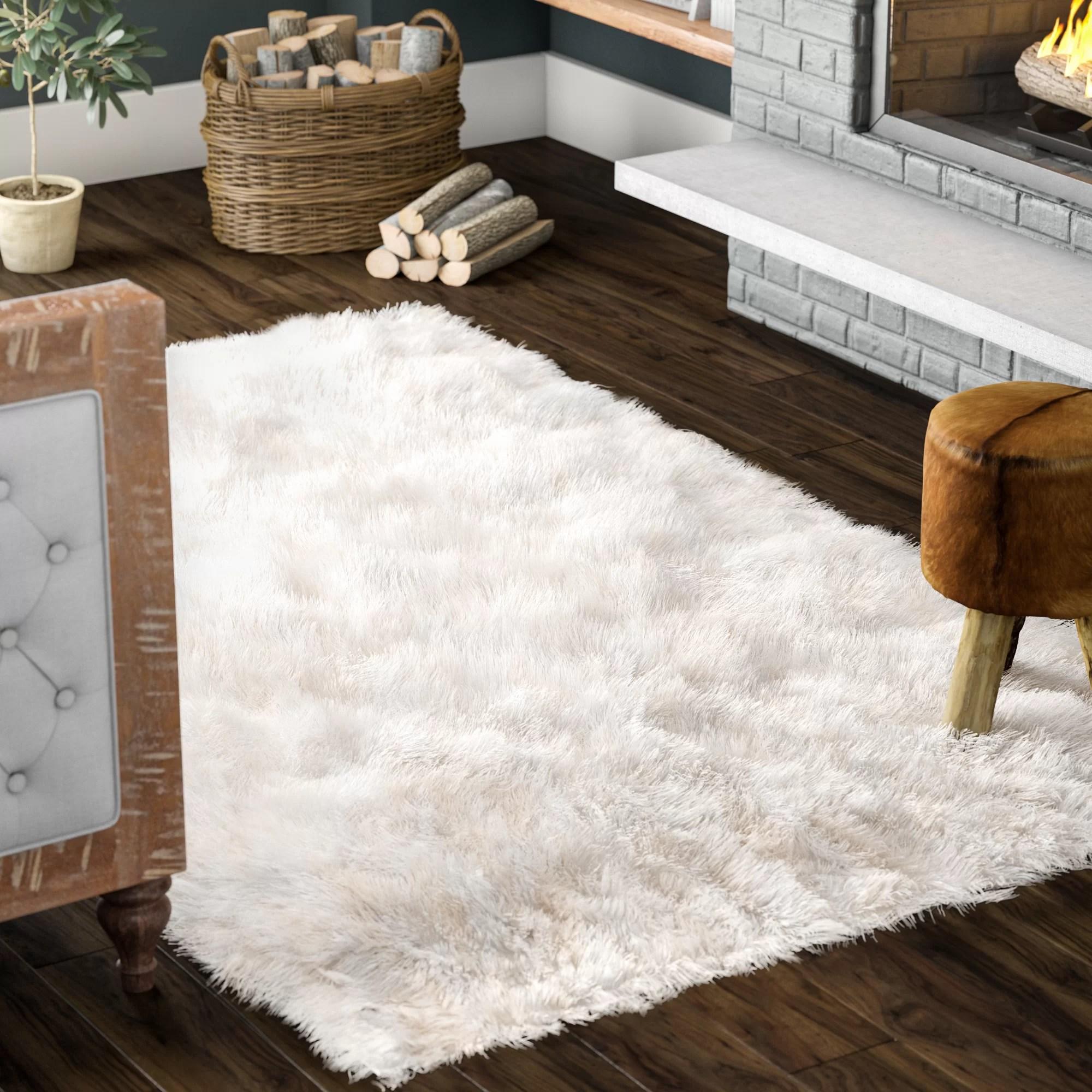 tapis blanc casse touffete shawnta