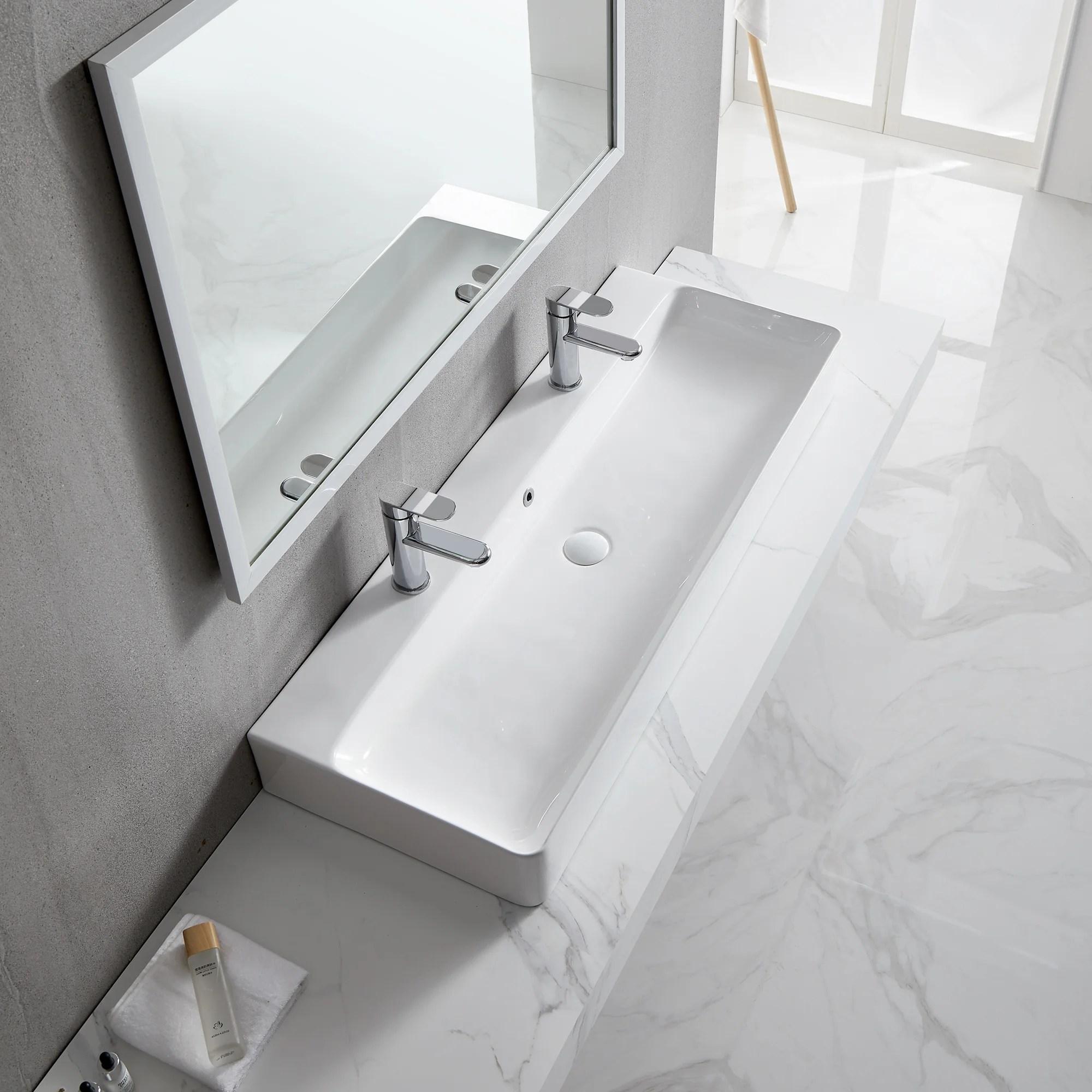 white ceramic rectangular trough bathroom sink with overflow