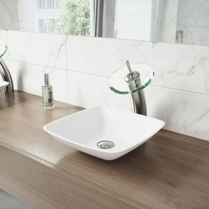 waterfall bathroom faucet with clear glass disc