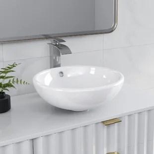 white ceramic circular vessel bathroom sink with overflow