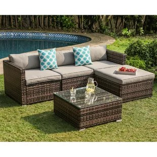bay isle home 5 piece outdoor furniture mottlewood brown wicker sofa w warm grey cushions glass top coffee table 2 teal pillows incl waterproof