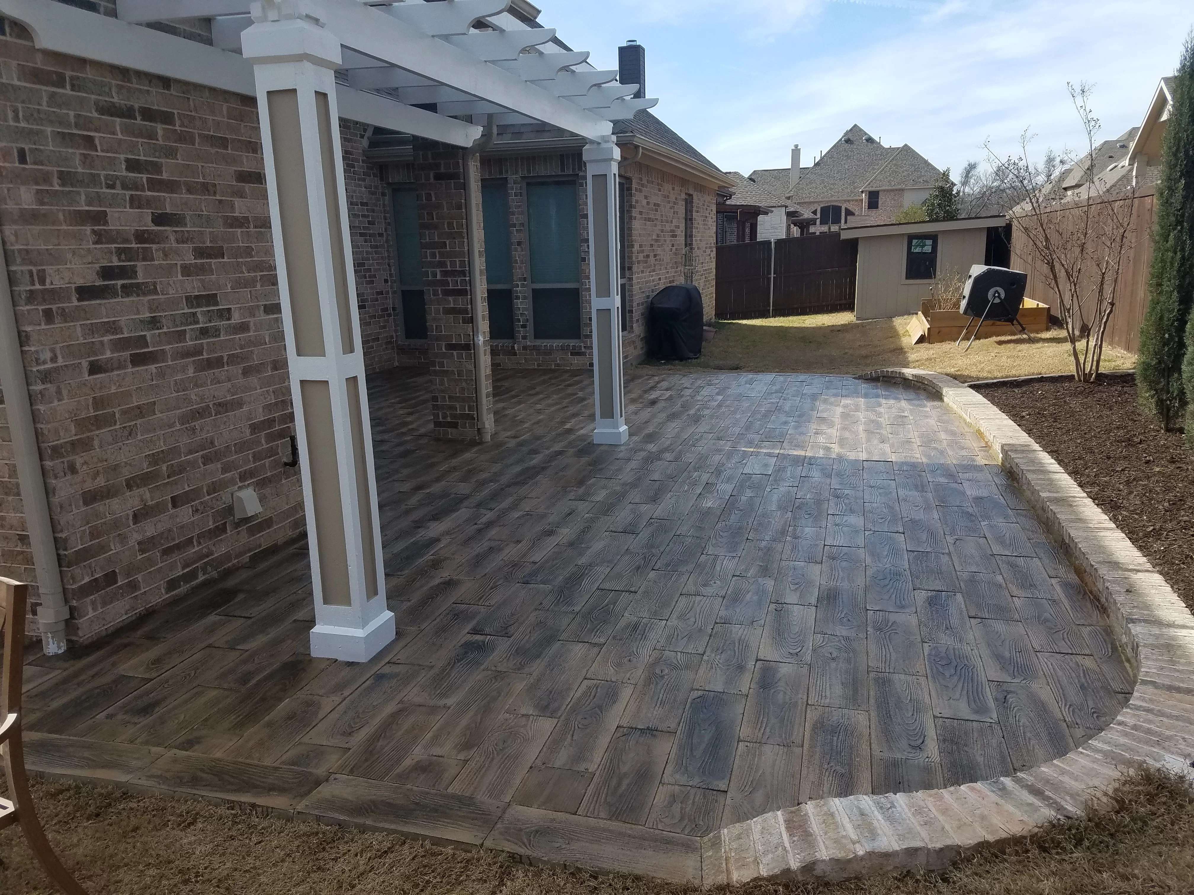 barnwood plank patio on a pallet paver in brown set