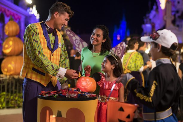 Cast Member Giving Out Candy at Mickey's Not-So-Scary Halloween Party at Magic Kingdom Park