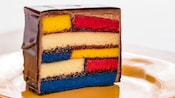 A classic Mondrian style painting is baked into a slice of cake and frosted in chocolate