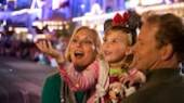 Mickey Mouse in a Santa costume with a girl at the Spectacle of Dancing Lights in Disney's Hollywood Studios