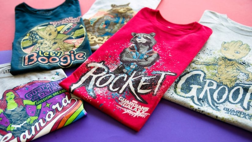 An assortment of Guardians of the Galaxy design T shirts are arranged on a table top