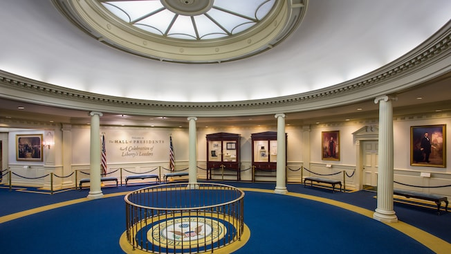 The grand rotunda of The Hall of Presidents with a sign saying