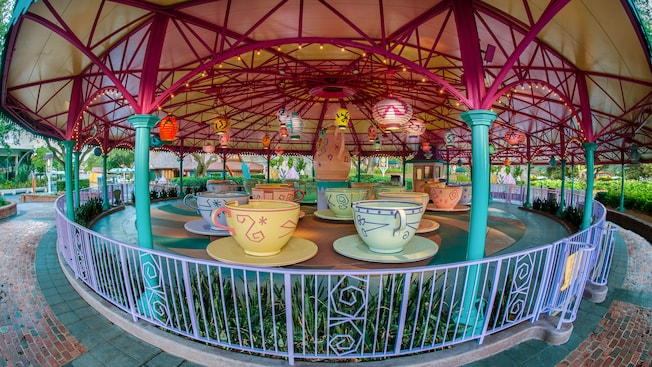 The Mad Tea Party attraction with oversized, colorful tea cups and a tea pot