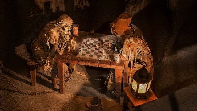 Skeletons play chess at Pirates of the Caribbean in Adventureland at Magic Kingdom park