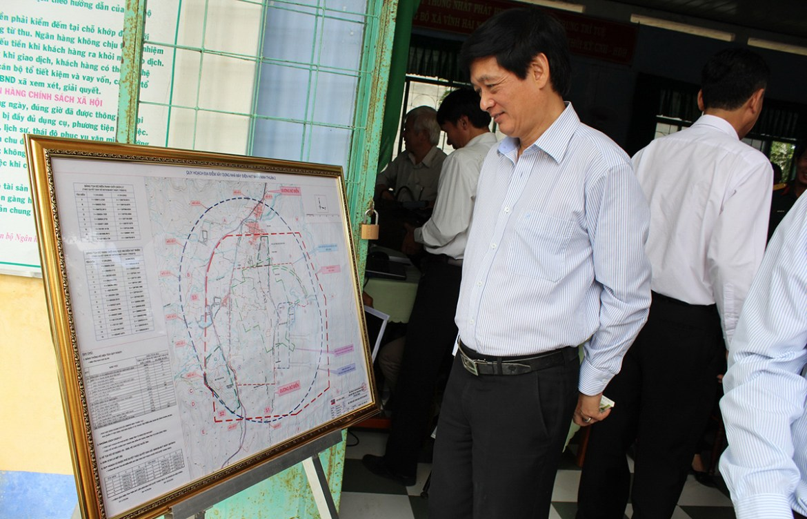<em>An official looks at a planning map for the Ninh Thuan 2 Nuclear Power Plant in Ninh Hai District, Ninh Thuan Province, Vietnam in a file photo taken in 2014. Photo: </em>Minh Tran / Tuoi Tre