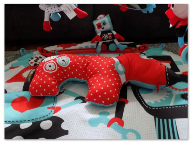This adorable Pup is the perfect pillow for Tummy Time play and the ears crinkle!