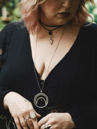 close up of layered necklaces and rings