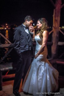 Bride and groom poseing for a late night wedding photo