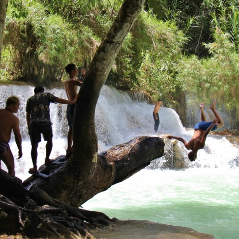 Man flips into water at Kuang Si Waterfalls in Luang Prabang, Laos