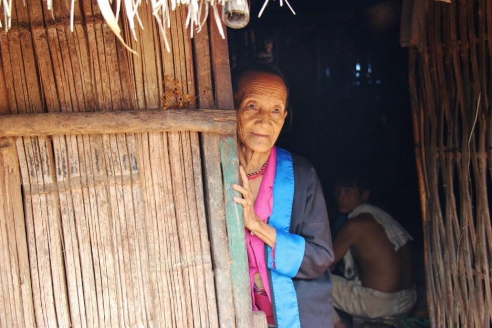 Woman in doorway in Ban Kok Eak Village, Laos