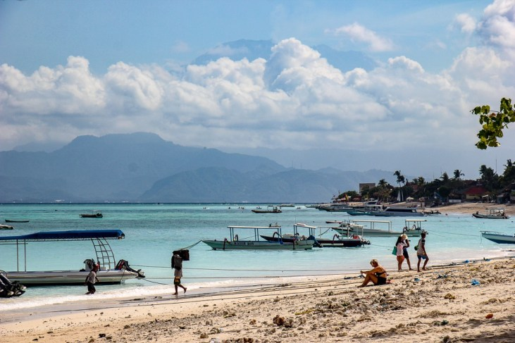 Boats moored in pale blue sea at Jungut Batu Beach on Nusa Lembongan, Bali, Indonesia