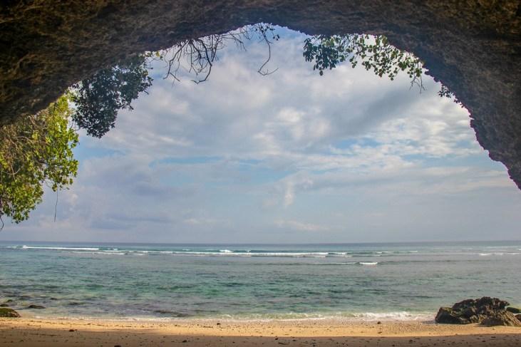 Inside the secret cave on Padang-Padang Thomas Beach in Uluwatu, Bali, Indonesia
