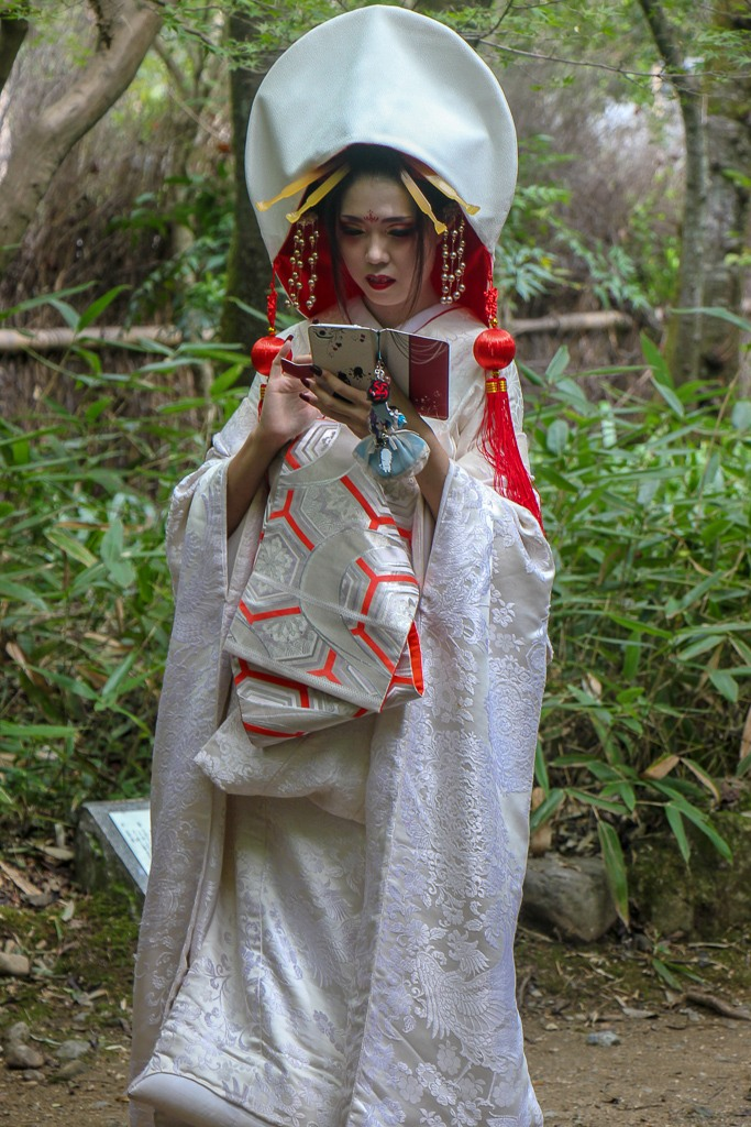 Girl in traditional dress on cell phone in Kyoto, Japan