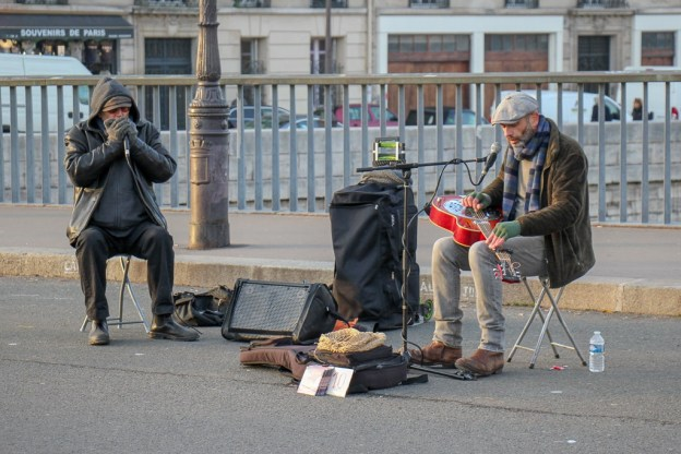 Two street musicians play for tips in Paris, France