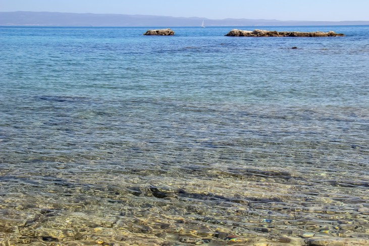 Crystal-clear water at Firule Beach in Split, Croatia