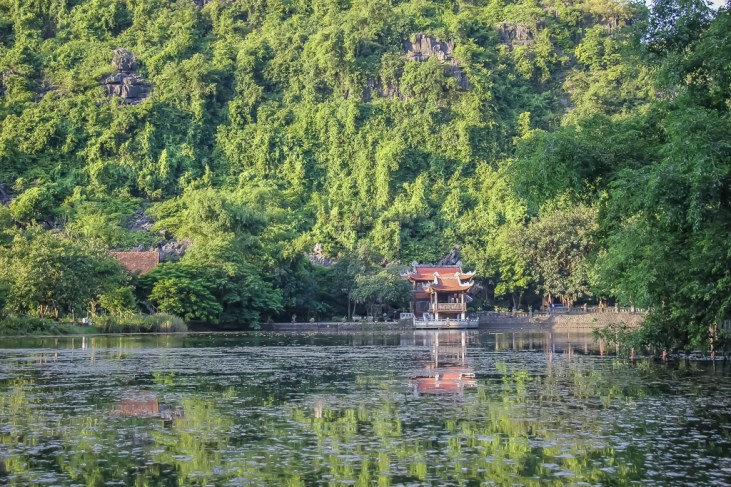Pagoda view across the water, Trang An, Ninh Binh Province, Vietnam
