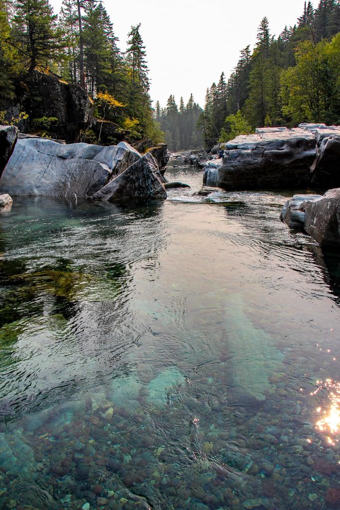 Clear blue water at Upper McDonald Creek Trail Waterfalls, Glacier National Park, Montana