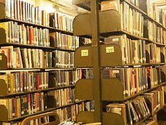 Books stacked in a library to signify resaerch