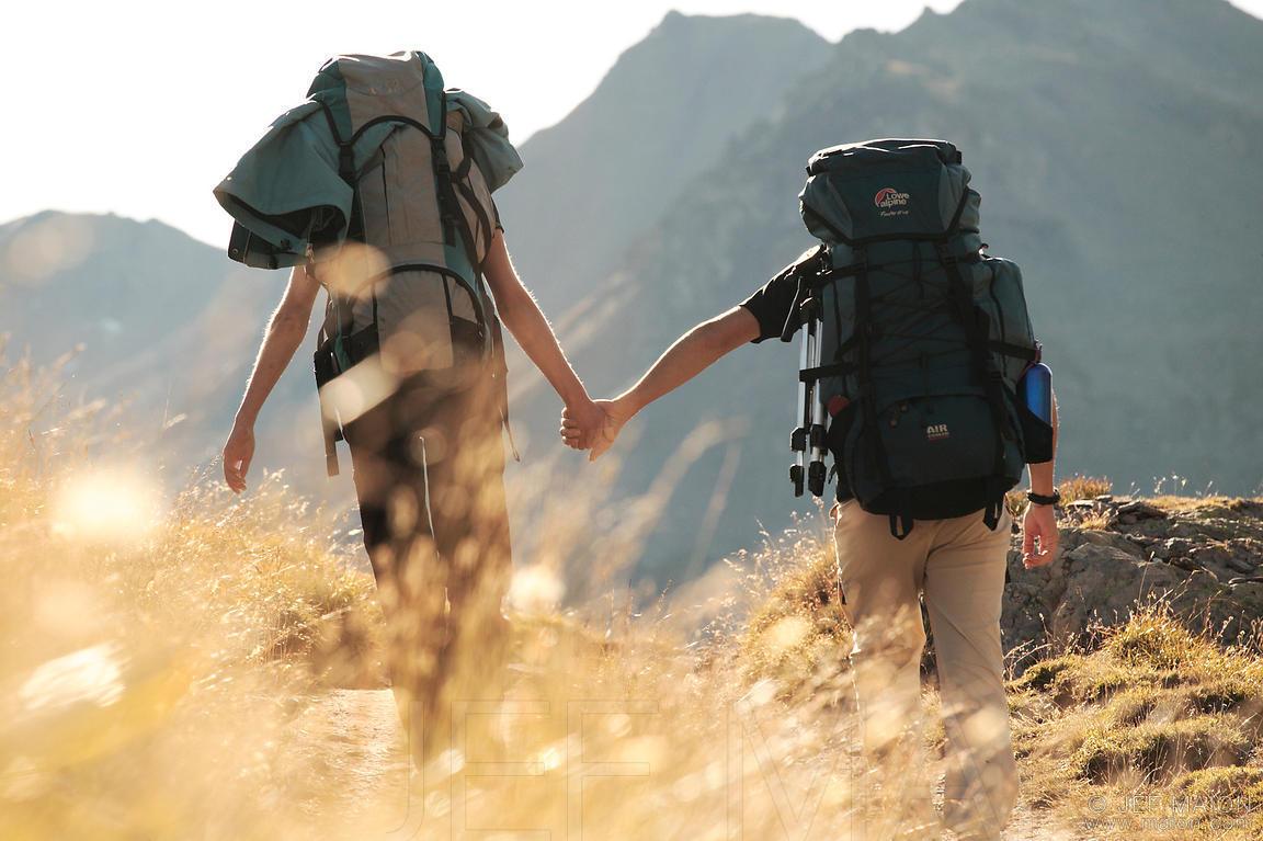 Backpackers couple walking hand in hand - SEDA College