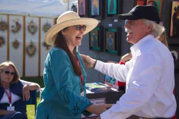 Mayor Rob Adams congratulates Karen Clarkson of Prescott, Arizona on winning First Place in Drawing. Karen is a 3 time winner at our festival!
