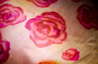 Roses painted over a black to silver ombre. Are the roses rising out of ashes, or falling in to them?