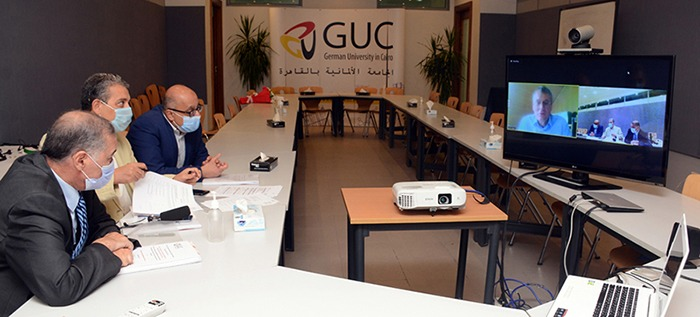 The discussion committee listens to the researcher Salwa Sami